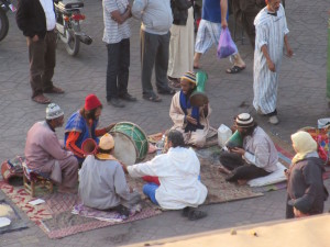 Drumming for dirhams.